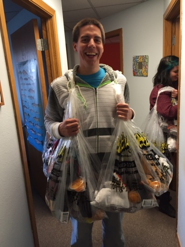 Ben Fletcher, a PA volunteer, cheerfully delivering care packages to the Road Home.