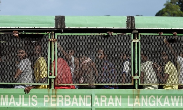 Bangladeshi and Rohingya migrants from Burma arrive at the Malaysian naval base in Langkawi. Malaysia received a better grade than the State Department's human rights experts wanted to give it. Photograph: Manan Vatsyayana/AFP/Getty Images